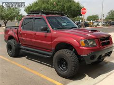 This 2001 Ford Explorer Sport Trac is running Eagle Alloy Series 058 wheels Achilles Desert Hawk Xmt tires with Stock Body Lift suspension. Ford Explorer Truck, Ford Explorer Sport, 4x4 Ford Ranger, Ranger Truck, Ford Sport Trac, Bronco Truck, Sports Track, Bronco Sports, Ford Pickup Trucks