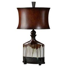 "Ceramic table lamp with a metallic bronze drip-motif and hourglass shade.  Product: LampConstruction Material: Ceramic, metal, and faux leatherColor: Aged ivory, rustic black, rusty red, bronze and beigeAccommodates: (1) Bulb - not includedDimensions: 30"" H x 18"" W x 10"" D"