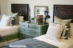 Teen boy's room ideas - plaid blanket, dark wood, green dresser, bedside lights
