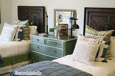 Teen boy's room ideas - plaid blanket, dark wood, green dresser, bedside lights