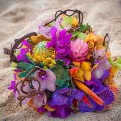 L. O. V. E. THIS ONE!!!!   Beautiful #kauai #wedding #bouquet Tropical Flowers and Kiwi branches