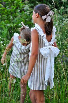 Vestido rayas verticales y escote trasero