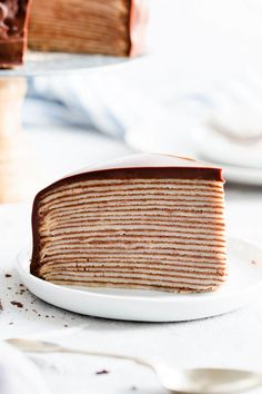Delicious and surprisingly easy recipe for chocolate crepe cake from Anna Banana Co. Beautiful layers of soft crepes with whipped chocolate cream create this visually stunning cake, making it perfect for any occasion! Crepe Cake Chocolate, Chocolate Crepes, Easy Cake Recipes, Cupcake Recipes, Dessert Recipes, Crepe Recipes, Banana Recipes, Waffle Recipes, Dessert Ideas