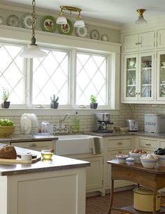 White farmhouse style kitchen. Dream kitchen! Look at those windows!