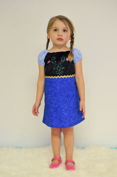 I think I could make this--Katie! Frozen Princess Anna Peasant Dress by AliandLu on Etsy, $25.00