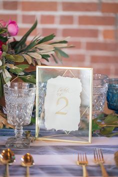 Modern Table Numbers in Gold Calligraphy | Kim Lyn Photography | Sequins and Stripes for an Industrial Glam Loft Wedding