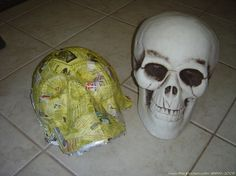Step by Step Instruction on recreating a skull out of paper mache with a skull prop