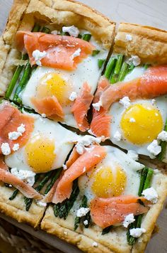 An impressive but simple brunch dish, this recipe for asparagus and egg tart with smoked salmon on a puff pastry crust will become a favourite. | livinglou.com #Eastertaining