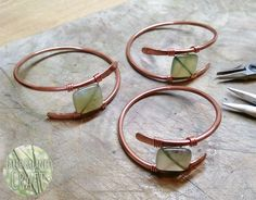 Work in progress, the raw stage of my sacred grove copper wire work bangle, each set with a jade stone.