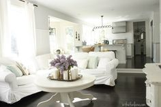 Life in the Fun Lane...love all the white and dark floors!
