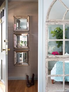 When designing living rooms with a cramped entryway, use decorative mirrors to keep the room light and bright. A trio of antique mirrors were installed to reflect the living room and bounce natural light into its otherwise small, dark entry.
