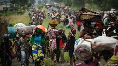 Thousands of people in the Democratic Republic of Congo flee the town of Sake, west of Goma, photo by Phil Moore/AFP