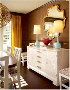 brown grasscloth with white accents, love that glossy white!! and that MIRROR! DANG