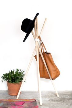 Assemble a cute minimal wood + leather hat rack with this easy DIY project.