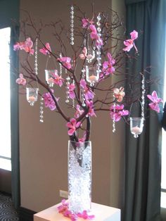 Beautiful branch centerpiece. You can get the crystal / bead strands at http://www.myonlineweddinghelp.com/search.php?keywords=crystal+strand+beads  #myonlineweddinghelp