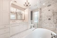 Traditional Master Bathroom with Signature Hardware Avon Acrylic Pedestal Tub, Calacatta Classic Marble Countertop