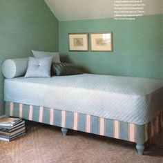 Make your own daybed out of a twin mattress set by adding wooden furniture legs to the bottom of the box spring. Paint legs, drill a hole into the center, insert a dowel screw, drill a hole in the box spring at each corner and screw in legs.