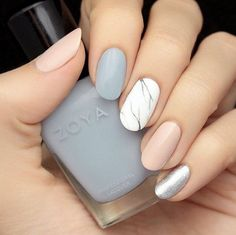 Spice up your typical pastel mani with a marbled accent nail. Keeping it in neutral shades prevents this look from going over the top. See more on House of Lashes' Instagram »  - GoodHousekeeping.com