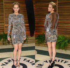 At the Vanity Fair afterparty, Jennifer Lawrence leaves behind her refined, contractually obligated couture and slips into a fashion-forward Tom Ford minidress with undies-nixing mesh cutouts.