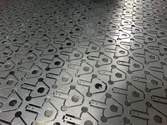CNC punching used to produce hundreds of small galvanised steel brackets Types Of Sheet Metal, Sheet Metal Work, Metal Manufacturing, Metal Projects, Galvanized Steel, Metal Working, Cnc, Tile Floor, Sheet Metal Shop