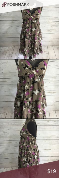 """Old Navy Butterfly Dress XS Old Navy Butterfly Dress XS. This dress features ribbon straps (not adjustable) Wmpire waist with 5 layers of butterfly printed fabric. Main color is Taupe with Black, Purple and cream colored butterflies. Perfect or a garden or Fairy Party. Length 35"""" Bust 29"""" waist 27"""" Old Navy Dresses"""