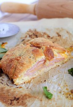 A fantastic Ham & Cheese Stromboli that can serve a family or double as appetizers for guests. Shared via //www.ruled.me/