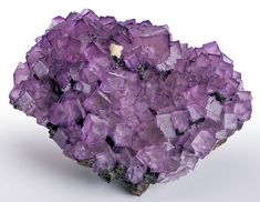 Gorgeous large cabinet plate of raspberry-purple Fluorite cubes clustered atop Sphalerite with Barite! A darker coloration accents the edges...