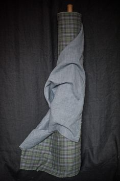 A Japanese double gauze organic cotton. Soft dusky blue, charcoal and dark green checkand houndstooth reverse.112cm wide.118g/m. Wash at 40 degrees, do not tumble dry. Soft Plaidis suitable for the following patterns in our Workbook: Bantam and Heron.