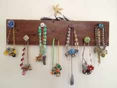 Drift wood with various antique knobs as necklace display