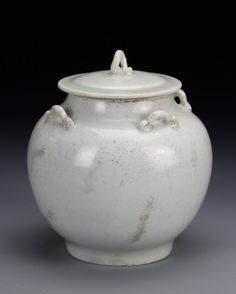 China, Song Period, white glazed jar with cover, bulbous body with footed base and containing cover, detailing of upright handles around body, and one on flat lid.