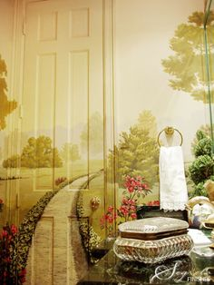 Mural sweeps across the door - perfect for a powder room....