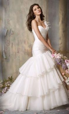 I feel like a drop waist or trumpet style dress would suit Adriane the best. Pinterest tells me these things.