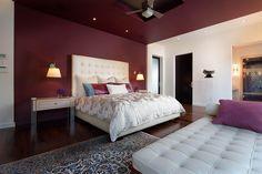 Exquisite bedroom in berry red [Design: Phil Kean Design Group]
