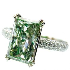 Fancy yellowish green diamond ring in 18-karat white gold with diamond melee by Nice Diamonds, New York.