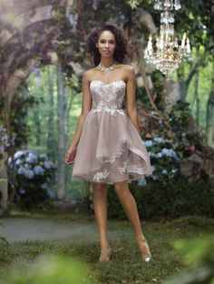 A Beautiful Bridesmaid Wearing A Tan, Cocktail Length Disney Princess Bridesmaid Dress With Embroidered Lace Details