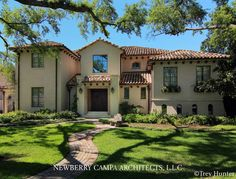 Spanish Colonial style home - concrete construction with steel windows and antique clay tile roof.