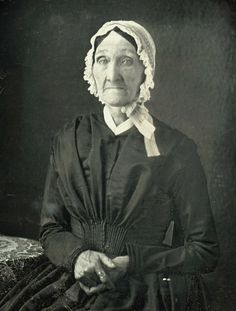 Dag from the 1840s [if dated by Grandmas dress and cap]which would mean she was born pre rev war.Think of all the changes her pretty blue eyes have seen in her lifetime.Her dress is plain but pretty and well made.Her hands show a usefull life.But her pretty lace and ruffeled cap is tied to the side in a rakeish bow..i like her.Wonder if she ever danced with George Washington?