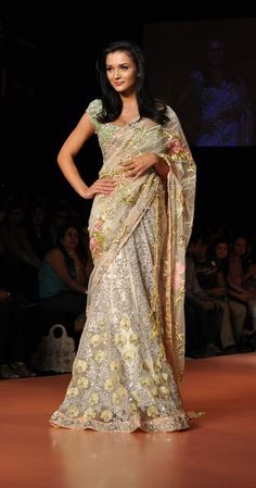 Model turned actress Amy Jackson in beautiful ivory lehenga saree designed by Bhairavi Jaikishan