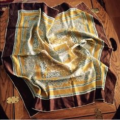 "Vintage Silk Print Scarf ~ Hand-rolled & Stitched A combination geometrical and floral print lies in this brown, teal, gold, white and lavender-gray Silk Scarf. Hand-rolled and hand-stitched, this lovely scarf measures approx. 34"" x 33"". Smoke and fragrance free. In great preowned vintage condition; no stains, marks or rips. (vintage & preowned items are never in perfect condition...they have been treasured and used). Please see additional scarves under ""accessories"" tab. Vintage Accessories…"