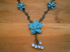The turquoise flowers in this necklace are handmade needle lace, a very time consuming technique were lots of little knots are made with needle and thread. The chain part is crocheted. In reality the color is mor turquoise than the pictures show.  Length: 50 cm / 19 inch  Our other necklaces are here: http://www.etsy.com/shop/PashaBodrum?section_id=6884137  Dont forget to check out the rest of our shop: http://www.etsy.com/shop/PashaBodrum