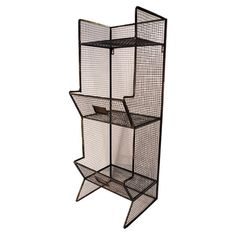 Freestanding metal shelf with an open wirework design and two bottom storage bins.   Product: ShelfConstruction Mater...