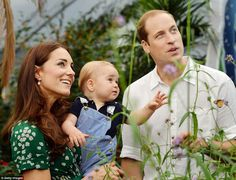 The Duchess of Cambridge holds Prince George as he and Prince William look on while visiti...