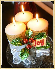Christmas decor... Love the candle cluster tied together with ribbon and holly tag.