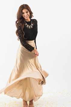 Our favorite skirt now comes in a pretty shimmery gold! This maxi skirt is all you could have asked for and more! With flowy layers, a flattering silohuette and gorgeous shimmery gold color, this skir