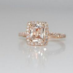 Champagne colored ring with peach saphire diamond. the one