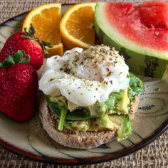I don't choose open face because it means less carbs...I choose it because food should be messy! Runny yolk layers of avocado and spinach on a whole wheat English muffin topped with hemp seeds .  #poachedeggs #avocado #wholewheat #englishmuffin #openface #hempseeds #sprinkles #fruit #strawberries #watermelon #orange #yummy #healthybreakfast #healthylifestyle #eatclean #happytummy #breakfast #love #ilovetocook #healthyfood #healthyfoodporn #foodie #hempfood #hippie #hippielife .  Great post…