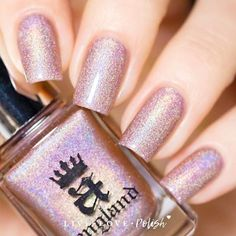 A-England Her Rose Adagio is a blush pinkpolish withsubtle prismatic shimmer. This nail polish is designed by Adina, creatorof A-England.Made in the United