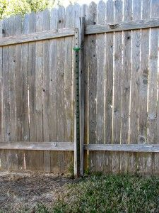 Broken fence post with steel t-post 'helper' post providing stability