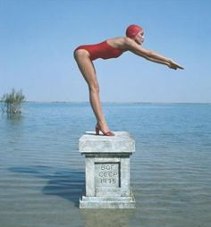 Jerry Hall in red swimsuit by Norman Parkinson, 1983.
