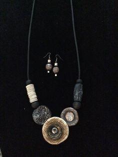Tribal polymer clay long pendant set by Karen Brueggemann.
